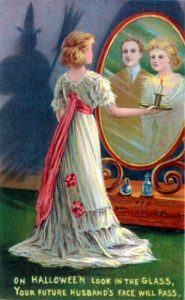 Halloween Greeting Card depicting the Magic Mirror game, circa 1904.