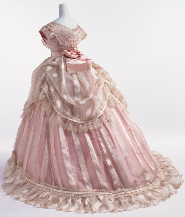 1866 pink striped silk taffeta evening dress Image via Kyoto Costume Institute