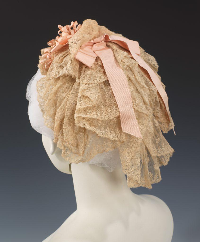 1880 cotton and silk pink ribboned cap via met museum