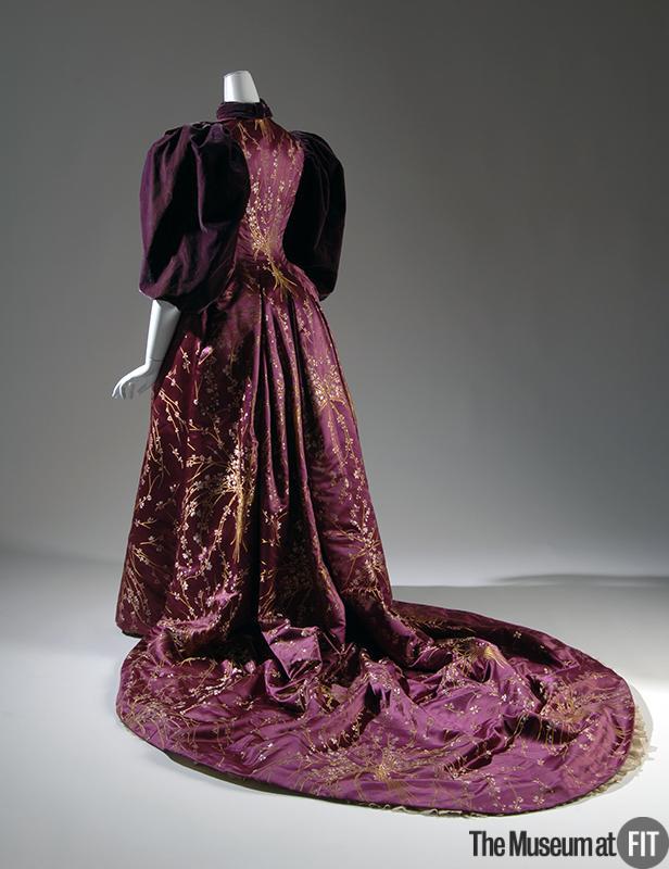 1894 evening dress of magenta floral brocade with plum velvet yellow silk satin