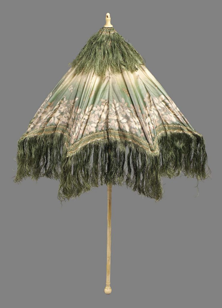 late 19th century parasol of taffeta ombrc3a9 green to cream with chinc3a9 design of leaf serpentine in brown and cream trimmed with green silk fringe lined with white china silk via mfa