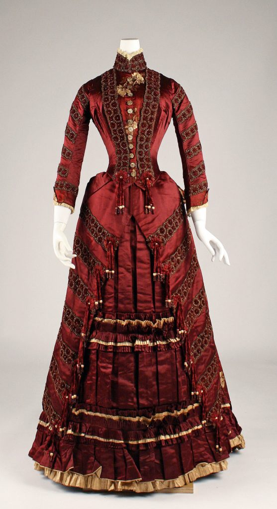 1879 french red silk dress with gold trim via met museum