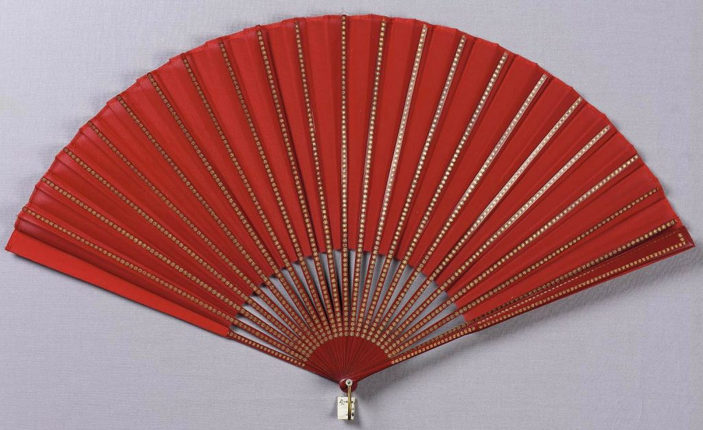mid 19th century french fan of red silk crepe leap mounted with red wooden sticks stamped with minute gold rosette via mfa bosto