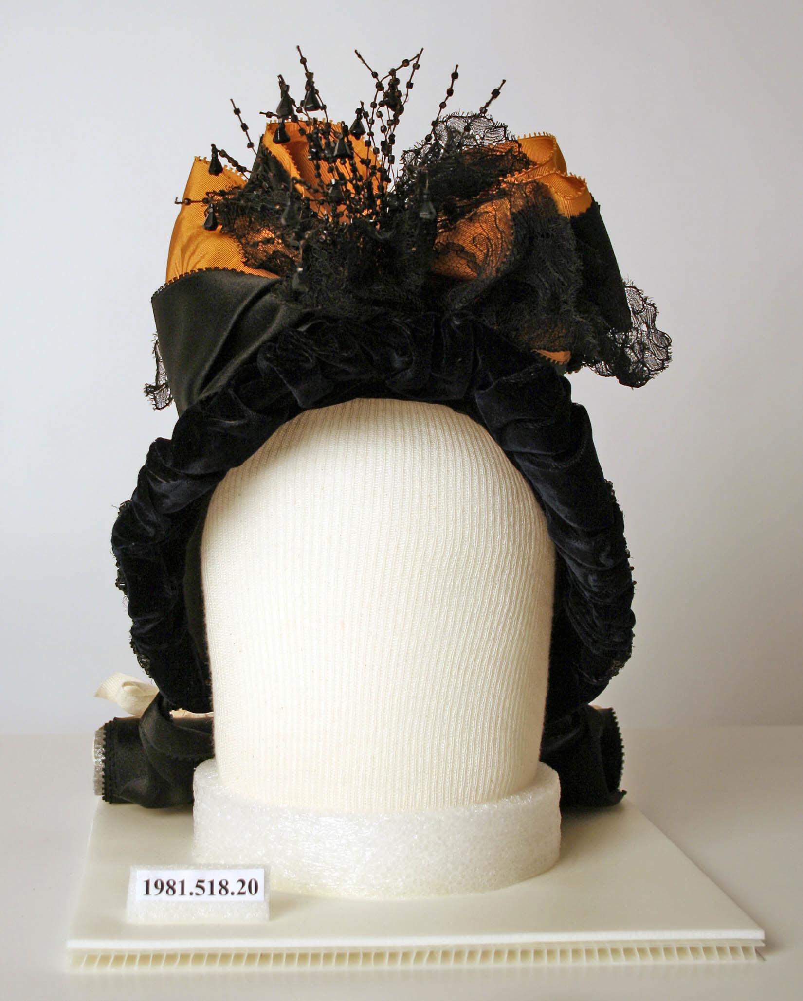 1888 american orange and black silk and jet hat 1 via met museum