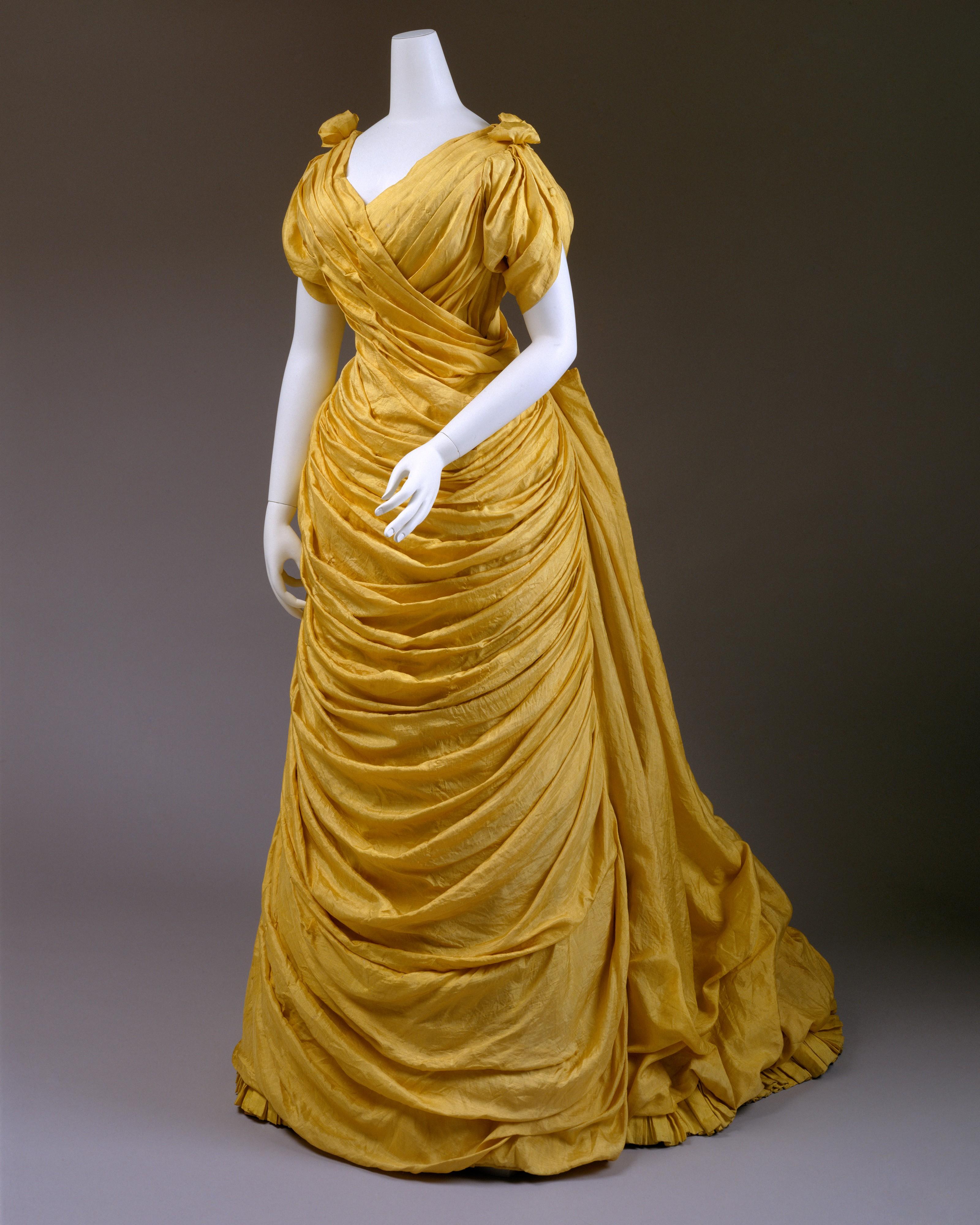 1880s liberty of london yellow silk evening dress 1 via met museum