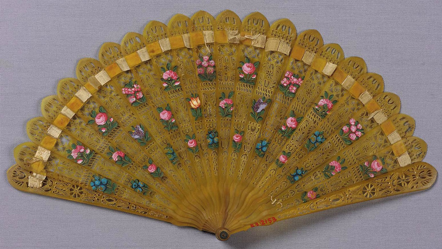 french fan first half of 19th century light yellow horn sticks with elaborate pierced design and polychrome minute floral moti