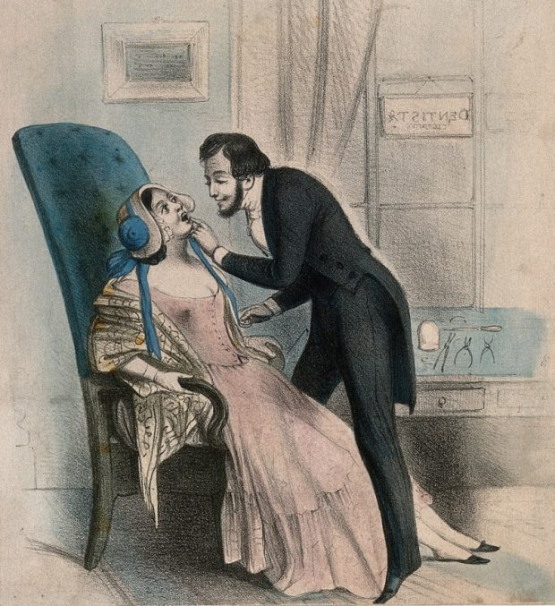 A dentist looking at a tooth of a very attractive female patient 19th century. Coloured lithograph Wellcome Collection. CC BY 4.0 e1537127206360