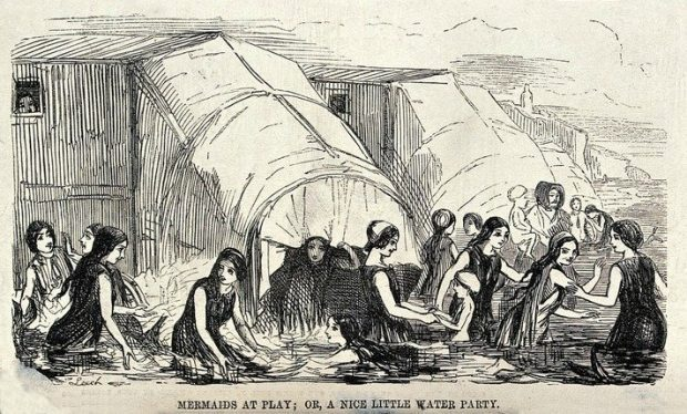 Women bathing in the sea near their bathing machines. Wood engraving by J. Leech. Wellcome Collection. e1563314398310